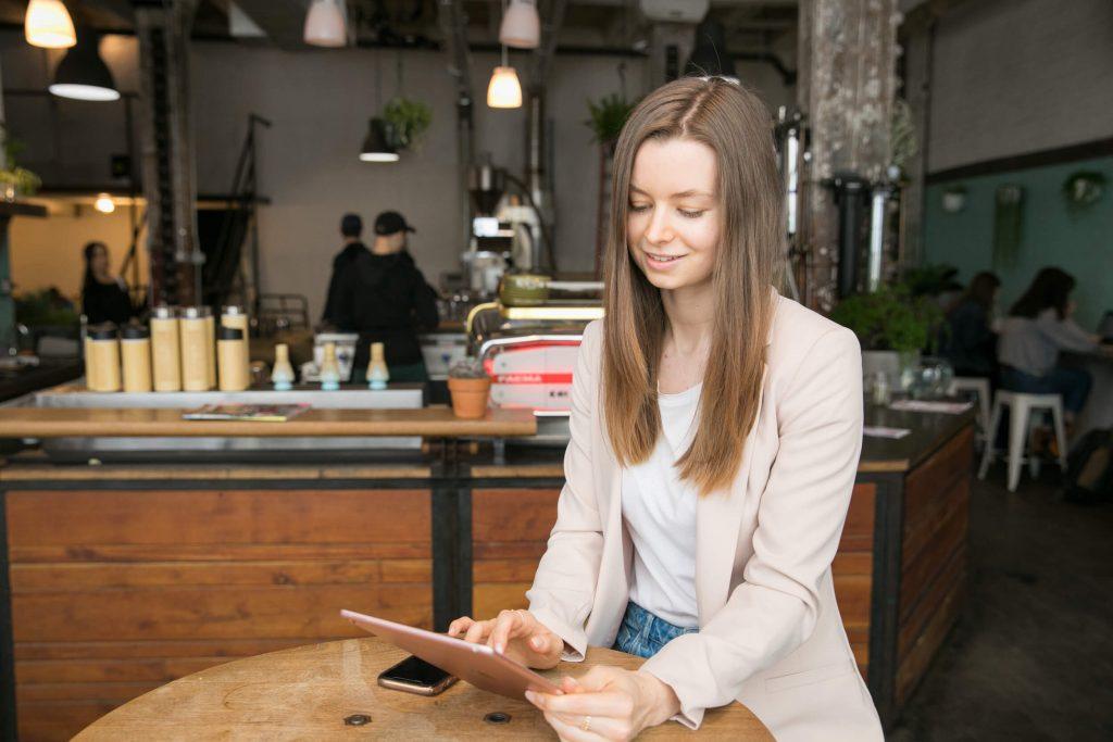 Steph Corrigan working on iPad in Brooklyn coffee shop