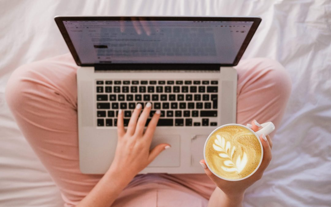 Laptop and latte art in bed